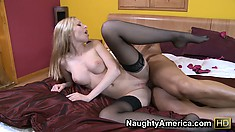 Aimee Addison's pale skin accentuates her sexy black stockings