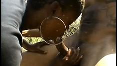Horny black chick satisfies her well-endowed lusty man outdoors
