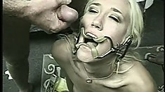 Slutty blonde in a gangbang gets humped by three dudes and swallows their loads