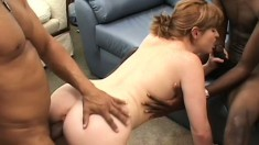 Cute redhead with tiny tits has two black guys stretching her snatch