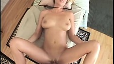 Sultry blonde with awesome tits gets fucked hard on the massage table