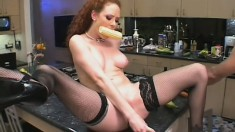 Horny redhead has fun with vegetables and a long cock in the kitchen